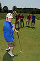 Spencer Stemple, foreground, poses for the camera as he plays golf during the Special Olympics at Coonskin Park in Charleston, W.Va., June 4, 2011 110604-F-NH898-468.jpg