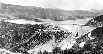 St. Francis Dam - View of the dam looking north, with water in its reservoir (February 1927)