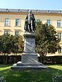 Statue of Sándor Kisfaludy and a large, resort building. Listed. - 3 Kisfaludy St, Balatonfüred.JPG