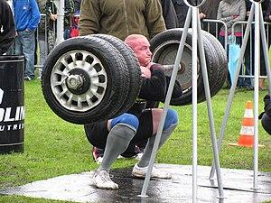 Strongman exercise: Front Squat Lift. Polski: ...