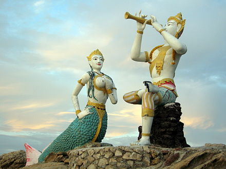 Sculptures of Phra Aphai Mani and the Mermaid from the epic poem Phra Aphai Mani, a work of Sunthorn Phu. Sunrise on Hat Saikaew, Koh Samet.jpg