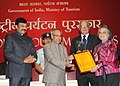 The President, Shri Pranab Mukherjee presenting the National Tourism Awards 2011-12, at a function, in New Delhi on March 18, 2013. The Minister of State (Independent Charge) for Tourism, Shri K. Chiranjeevi is also seen (3).jpg