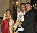 The President, Smt. Pratibha Devisingh Patil presenting the Padma Shri Award to Shri Gagan Narang , at an Investiture Ceremony II, at Rashtrapati Bhavan, in New Delhi on April 01, 2011.jpg