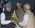 The Prime Minister, Dr. Manmohan Singh received by the West Bengal Governor Shri Gopalkrishna Gandhi and West Bengal Chief Minister Shri Buddhadeb Bhattacharjee on his arrival at Kolkata Airport on December 23, 2006.jpg