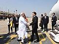 The Prime Minister, Shri Narendra Modi receiving the President of the French Republic, Mr. Emmanuel Macron, on his arrival, at Varanasi, Uttar Pradesh on March 12, 2018.jpg