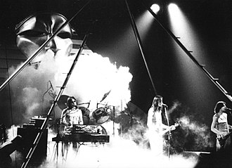 Todd Rundgren - Utopia, touring to support the Ra album at the Fox Theatre in Atlanta, Georgia; 1977, L to R: Roger Powell, Rundgren, Kasim Sulton
