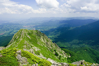 Panorama of Stara Planina. Its highest peak is Botev at a height of 2,376 m. Todorini kukli north.jpg
