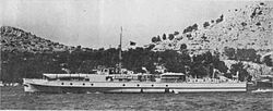 a black and white photograph of a ship underway