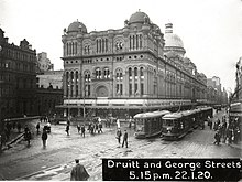 Trams on George Street in front of the QVB (2687730703).jpg