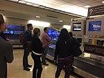 Travelers watch presidential debate on monitors at Ronald Reagan Washington National Airport baggage claim.jpg