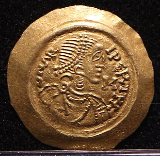 Aripert II - Tremissis minted at Pavia, bearing an effigy of Aripert II.