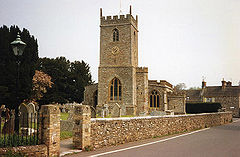 Stone building with square tower.