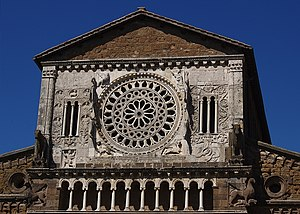Tuscania - The rose window and the ''loggetta'' of the church of San Pietro.