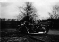 Two AJS motorcycles each with sidecar.png