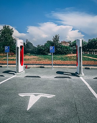 Tesla Supercharger - Supercharger stall with cable and parking space