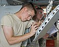 U.S. Air Force Airman Basic Kyle King and Airman 1st Class Ian Tanafon, both with the 364th Training Squadron, practices removing and installing hydraulic components on a T-38 Talon aircraft at Sheppard Air 110923-F-NF756-010.jpg