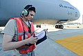 U.S. Air Force Senior Airman Justin Williford, a C-5 Galaxy aircraft crew chief assigned to the 436th Aircraft Maintenance Squadron, reviews a technical manual during a refueling operation at Dover Air Force 131002-F-VV898-008.jpg