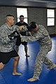 U.S. Army Capt. Daniel Mckeel, assigned to the 1st Battalion, 306th Infantry Regiment, 188th Infantry Brigade, attempts to defend himself from Sgt. 1st Class Patrick Antonino, with the 2nd Battalion, 306th Field 121213-A-MB460-001.jpg