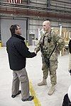 U.S. Deputy Secretary of Defense Ash Carter, left, gives a coin to an Airman at Bagram Airfield, Parwan province, Afghanistan, Nov. 28, 2013 131128-A-NQ567-188.jpg