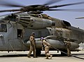 U.S. Marine Corps Lance Cpl. Samantha Medellin, center, a nozzle operator with Marine Wing Support Squadron (MWSS) 274, prepares to attach a fuel hose to a CH-53E Super Stallion helicopter Sept 140903-M-EN264-289.jpg