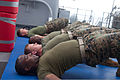U.S. Marines perform the back plank position during Marine Corps martial arts training aboard the dock landing ship USS Oak Hill (LSD 51) during Amphibious-Southern Partnership Station (A-SPS) 2012 in 111009-A-WF228-019.jpg