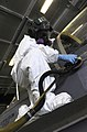 U.S. Navy Aviation Structural Mechanic 1st Class Gregory Priebe performs corrosion control maintenance on an F-A-18F Super Hornet aircraft assigned to Strike Fighter Squadron (VFA) 41 aboard the aircraft carrier 130326-N-YW024-009.jpg