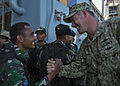 U.S. Navy Electronics Technician 1st Class Anthony Nekervis, right, assigned to Maritime Civil Affairs and Security Training Command, shakes hands with an Indonesian sailor with the special operations team 130524-N-IY633-290.jpg