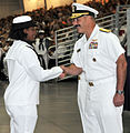U.S. Navy Rear Adm. Mark D. Guadagnini, deputy commander with fleet management and chief of staff of U.S. Fleet Forces Command, congratulates Seaman Recruit Aeisha Burke for receiving the Navy Club of the U.S 120817-N-IK959-266.jpg