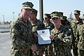 U.S. Navy Vice Adm. John W. Miller, left, commander of U.S. Naval Forces Central Command, U.S. 5th Fleet, Combined Maritime Forces, presents Master-at-Arms 3rd Class Travis Hembree, assigned to Commander Task 130828-N-DY265-060.jpg