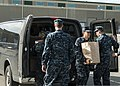 U.S. Sailors assigned to the aircraft carrier USS Abraham Lincoln (CVN 72) unload donated food from a vehicle Nov. 25, 2013, at the Virginia Peninsula Food Bank in Newport News, Va 131125-N-CH132-014.jpg