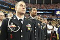 U.S. Soldiers assigned to the 160th Special Operations Aviation Regiment (Airborne), stand at the position of attention during the playing of the national anthem for a Final Four basketball game at the Georgia 130406-A-BZ540-020.jpg