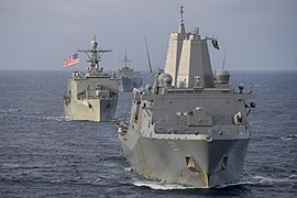USS America (LHA 6) conducts an exercise with USS Blue Ridge (LCC 19), USS Green Bay (LPD 20) and USS Germantown (LSD 42).jpg