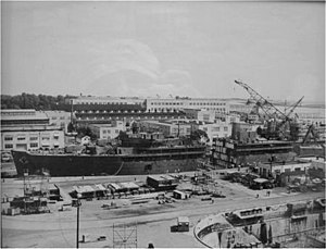 USS Proteus (AS-19) - USS Proteus being lengthened at Charleston in 1959.