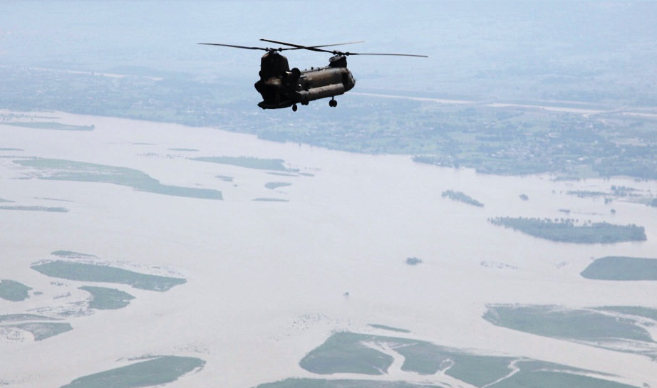 US Army helicopter flies over a flood-affected area of Pakistan Cut2