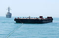 US Navy 020804-N-3580W-009 A tug pulling oil barges suspected of smuggling illegal oil out of Iraq is followed by USS Hopper.jpg
