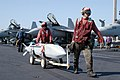 US Navy 030402-N-6817C-207 Aviation Ordnancemen move ordnance on the flight deck to nearby aircraft aboard USS Abraham Lincoln (CVN 72).jpg