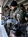 US Navy 040110-N-6157F-004 Members of Naval Mobile Construction Battalion Two Three (NMCB-23) check out their MCU-2P gas masks.jpg