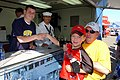 US Navy 040501-N-6501M-001 Driver Casey Atwood presents an autograph and shakes hands with long-time little fan.jpg