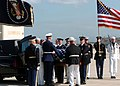US Navy 040609-N-9712C-001 Ceremonial Honor Guard personnel remove former President Ronald Reagan's flag-draped mahogany casket from a hearse.jpg