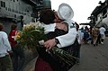 US Navy 040918-N-6371Q-109 Photographer's Mate 1st Class James E. Perkins, assigned to the amphibious assault ship USS Wasp (LHD 1), reunites with a loved one during Wasp's homecoming celebration.jpg