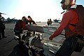 US Navy 041108-N-8704K-002 Aviation Ordnancemen move a skid of Mk-83 1,000 pound general-purpose bombs fitted with proximity fuzes across the flight deck of the aircraft carrier USS John F. Kennedy (CV 67).jpg