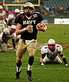 US Navy 041230-N-9693M-167 U.S. Naval Academy Midshipman 1st Class Aaron Polanco runs for a touchdown in the 3rd quarter of play against the Lobos of New Mexico at the Emerald Bowl in San Francisco.jpg