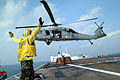 US Navy 050224-N-0357S-106 An MH-60S Seahawk helicopter, assigned to Helicopter Combat Support Squadron Five (HC-5), picks up boxes containing he personnel belongings of a group of healthcare workers from the non-governmental.jpg