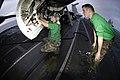 US Navy 050802-N-8604L-015 Aviation Electronics Technician 3rd Class Steven Lauderdale, and Aviation Electronics Technician Airman Joshua Broadway, perform maintenance on an F-A-18C Hornet.jpg