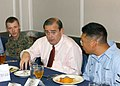 US Navy 060119-N-3293G-030 The Honorable Jerry F. Costello (D-IL) talks with Aviation Boatswain's Mate 3rd Class Michael Little and Sgt. Joseph Pruiett during a luncheon aboard the amphibious assault ship USS Tarawa (LHA 1).jpg