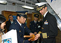 US Navy 060209-N-9860Y-014 City of Muroran Chief of Police, Mr. Toshikatsu Kimura, presents a set of bokken or wooden swords to Commanding Officer, USS Blue Ridge (LCC 19) Capt. Jeff Bartkoskij.jpg
