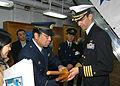 US Navy 060209-N-9860Y-014 City of Muroran Chief of Police, Mr. Toshikatsu Kimura, presents a set of bokken or wooden swords to Commanding Officer, USS Blue Ridge (LCC 19) Capt. Jeff Bartkoskij.jpg