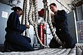 US Navy 060305-N-7241L-039 Boatswain's Mate 3rd Class Shaquita Smith, left, and Seaman Patrick Schubert, right, finish splicing a mooring line by tying off loose ends, aboard the Nimitz-class aircraft carrier USS Theodore Roose.jpg
