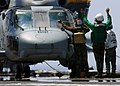 US Navy 060504-N-7359L-007 A Sailor washes the windshield of an SH-60 Seahawk helicopter assigned to the.jpg