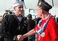 US Navy 061111-N-2248M-069 Operations Specialist 3rd Class Andrew Petrie assigned to the amphibious assault ship USS Wasp (LHD 1), greets his finance's father as returning from deployment.jpg